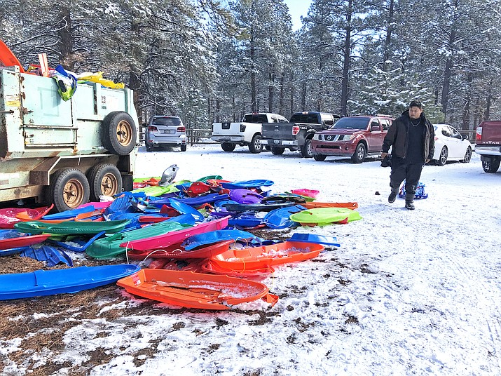 Discarded sleds pile up at Oak Hill Snowplay Area in Kaibab National Forest. Most forest employees are furloughed during the partial government shutdown leaving large swaths of public land without caretakers. (Wendy Howell/WGCN)