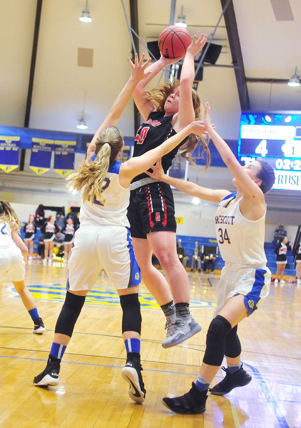 Bradshaw Mountain's Delanie Clark shoots over a pair of defenders as the Bears beat the Prescott Badgers Tuesday, January 8, 2019 in Prescott. (Les Stukenberg/Courier).