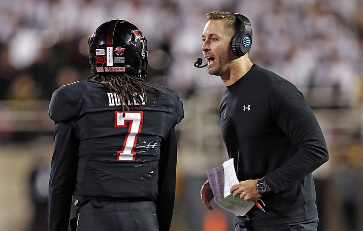 In this Saturday, Nov. 3, 2018, file photo, Texas Tech coach Kliff Kingsbury talks to quarterback Jett Duffey (7) during a timeout in the second half of an NCAA college football game against Oklahoma in Lubbock, Texas. Duffey is expected to get his second start on Saturday against Texas. (Brad Tollefson/AP, file)