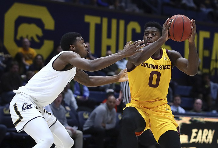 Arizona State guard Luguentz Dort, right, works the ball against California's Darius McNeill during the first half of an NCAA college basketball game Wednesday, Jan. 9, 2019, in Berkeley, Calif. (Ben Margot/AP)