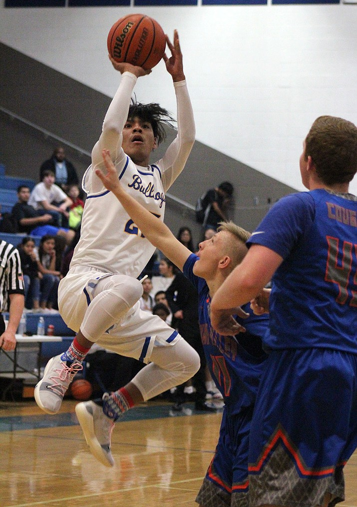 Rider Havatone made his Bulldogs debut with 12 points, all of which came from 3-point range Tuesday night in a 72-66 loss to Chino Valley. (Photo by Beau Bearden/Daily Miner)