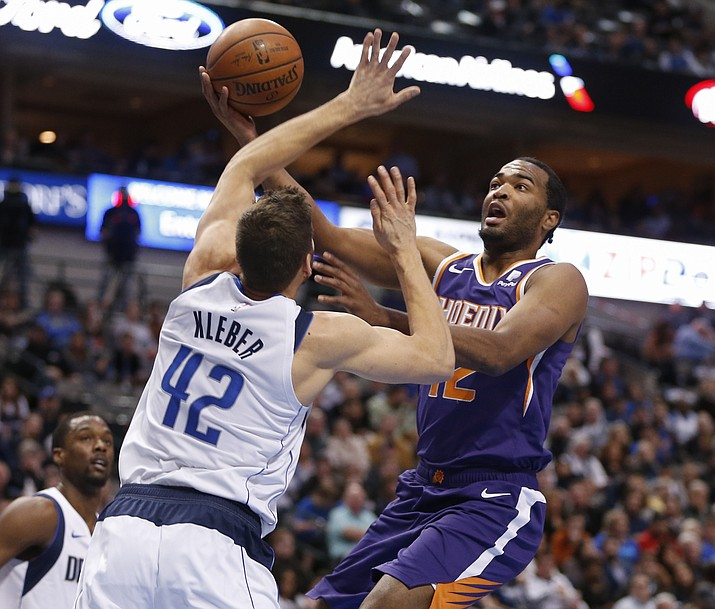 Phoenix Suns forward T.J. Warren (12) shoots in front of Dallas Mavericks forward Maximilian Kleber (42) during the first half of an NBA basketball game, Wednesday, Jan. 9, 2019, in Dallas. (Jim Cowsert/AP)