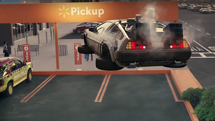 """Walmart's new grocery pickup commercial features iconic movie cars including: Batmobile, Ghostbuster's Ecto-1, Cinderella's carriage, Transformers' Bumblebee, Knight Rider's K.I.T.T., Scooby Doo's Mystery Machine, the DeLorean time machine from """"Back to the Future"""" and more. (Walmart)"""