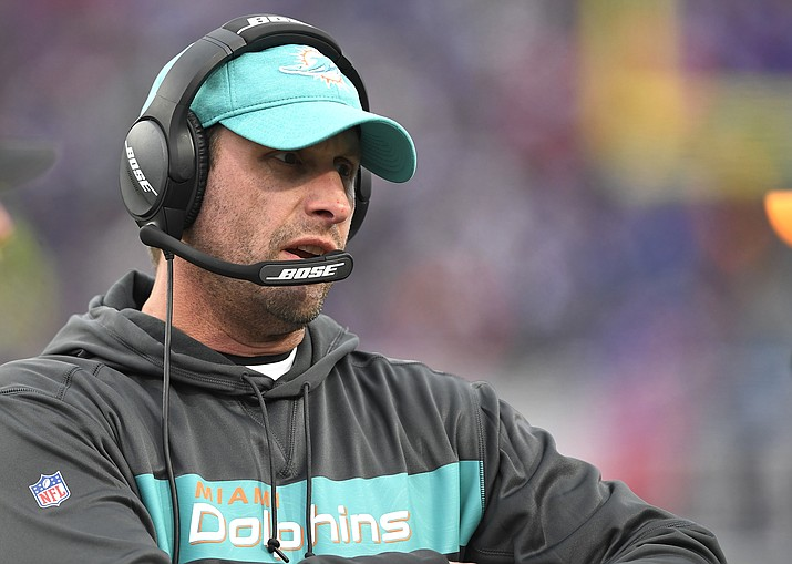 In this Sunday, Dec. 30, 2018 file photo, Miami Dolphins head coach Adam Gase watches the first half of an NFL football game against the Buffalo Bills in Orchard Park, N.Y. A person familiar with the decision says the New York Jets have hired former Miami Dolphins coach Adam Gase as their head coach. The person spoke to The Associated Press on condition of anonymity on Wednesday, Jan. 9, 2019 night because the team had not yet announced the hiring.(Adrian Kraus/AP, file)