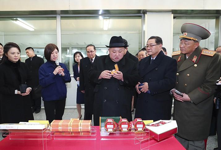 North Korean leader Kim Jong Un, center, in hat, visits a facility for Chinese traditional medicine maker Tong Ren Tang Wednesday, Jan. 9, 2019, in Beijing. A special train believed to be carrying Kim Jong Un departed Beijing on Wednesday after a two-day visit by the North Korean leader to the Chinese capital. (Xie Huanchi/Xinhua via AP)