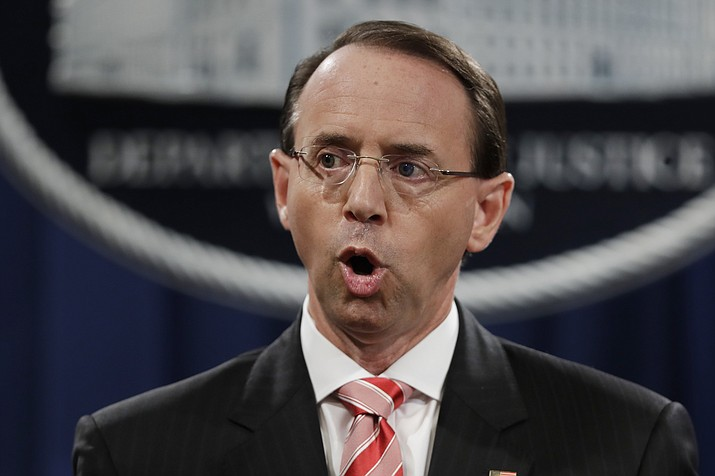 In this July 13, 2018 file photo, Deputy Attorney General Rod Rosenstein speaks during a news conference at the Department of Justice in Washington. Rosenstein is expected to leave his position soon after William Barr is confirmed as attorney general. That's according to a person familiar with the plans who was not authorized to discuss them on the record and spoke to The Associated Press on condition of anonymity. (Evan Vucci/AP)