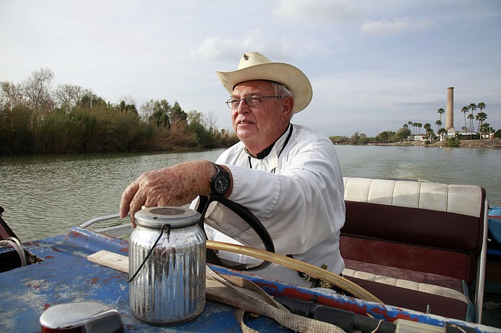 In this Tuesday, Jan. 8, 2019 photo, father Roy Snipes, pastor of the La Lomita Chapel, shows Associated Press journalists the land on either side of the Rio Grande at the US-Mexico border in Mission, Texas. Portions of Father Snipes' church land in Mission could be seized by the federal government to construct additional border wall and fence lines. (AP Photo/John L. Mone)