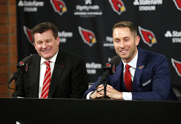 Arizona Cardinals new NFL football head coach Kliff Kingsbury, right, and team owner Michael Bidwell, address the media, Wednesday, Jan. 9, 2019, in Tempe, Ariz. (AP Photo/Rick Scuteri)