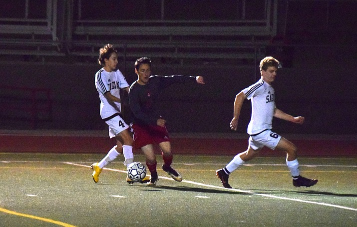 Mingus sophomore midfielder Domanic Renik dribbles through the Saguaro defense to score the game winning goal in the Marauders' 3-2 victory over the Sabercats on Tuesday night at home. VVN/James Kelley
