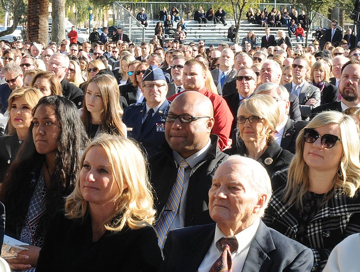 Companies and individuals that donated cash to finance Monday's inaugural got seats close to the front, right behind family members of those being sworn in and other elected officials. (Capitol Media Services photo)