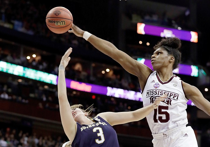 In this April 1, 2018, file photo, Mississippi State's Teaira McCowan (15) blocks a shot by Notre Dame's Marina Mabrey (3) during the first half in the final of the women's NCAA Final Four college basketball tournament in Columbus, Ohio. The Associated Press polled a panel of WNBA coaches and general managers for a mock draft of the two rounds this spring. The top three picks remained the same from the first mock draft with Teaira McCowan, Asia Durr and Kalani Brown going 1-2-3. (Tony Dejak/AP, file)