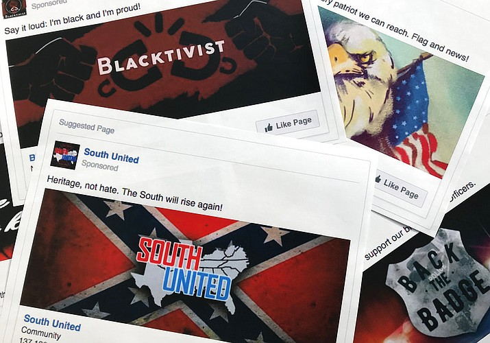 This Nov. 1, 2017 file photo shows prints of some of the Facebook ads linked to a Russian effort to disrupt the American political process and stir up tensions around divisive social issues, released by members of the U.S. House Intelligence committee, in Washington. According to a study published Wednesday, Jan. 9, 2019 in Science Advances, people over 65 and conservatives shared far more false information in 2016 on Facebook than others. (AP Photo/Jon Elswick, File)