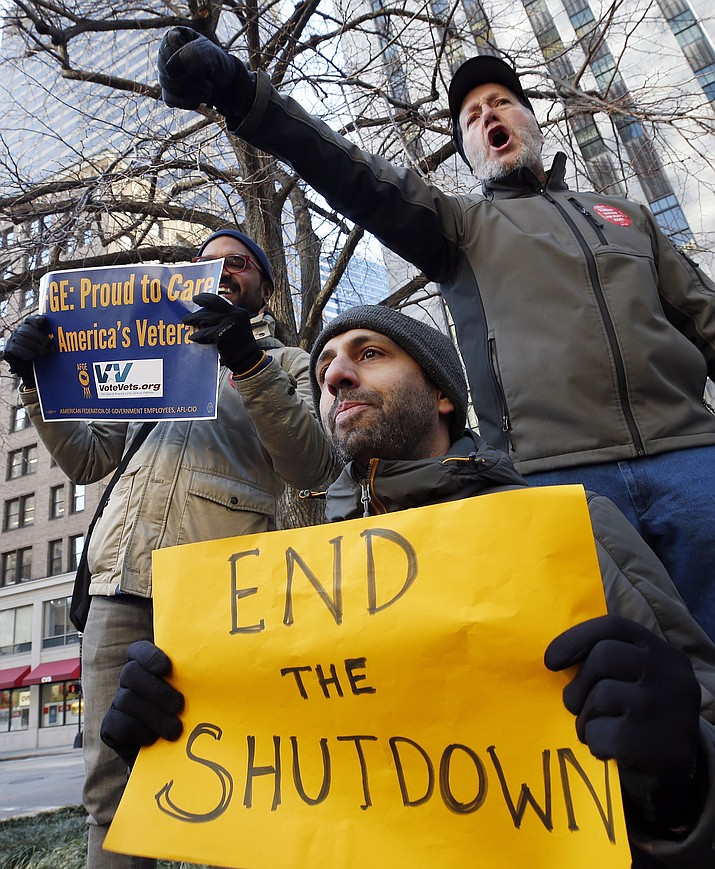 Government workers and their supporters hold signs during a protest in Boston, Friday, Jan.11, 2019. The workers rallied with Democratic U.S. Sen. Ed Markey and other supporters to urge that President Donald Trump put an end to the shutdown so they can get back to work. (Michael Dwyer/AP)