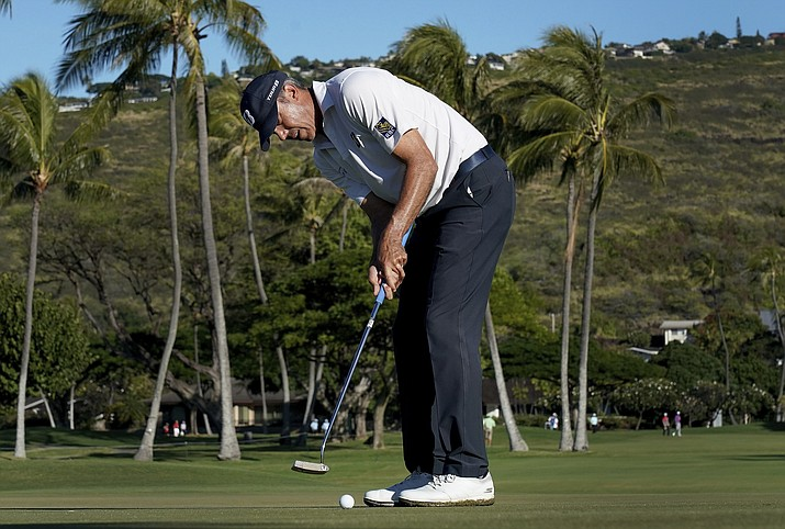 Matt Kuchar putts on the 13th green during the second round of the Sony Open PGA Tour golf event, Friday, Jan. 11, 2019, at Waialae Country Club in Honolulu. (Matt York/AP)