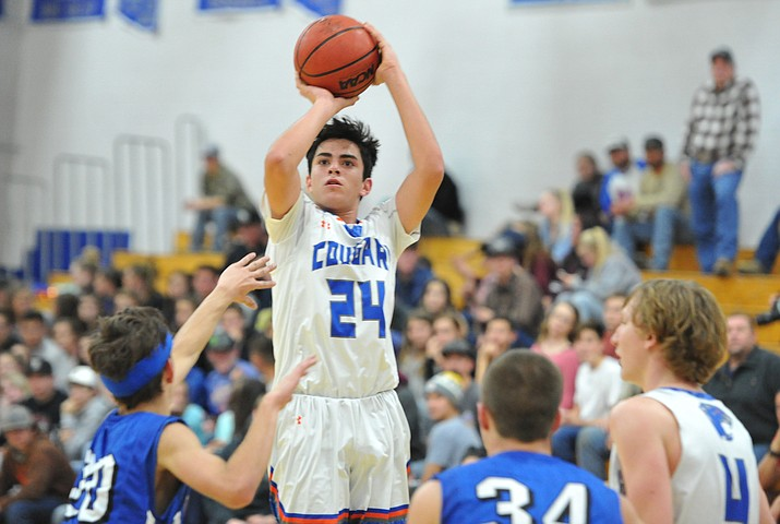 Chino Valley's Daniel Martinez goes up for a shot as the Cougars take on Camp Verde, Thursday, Jan. 10, 2018  in Chino Valley. (Les Stukenberg/Courier, file)