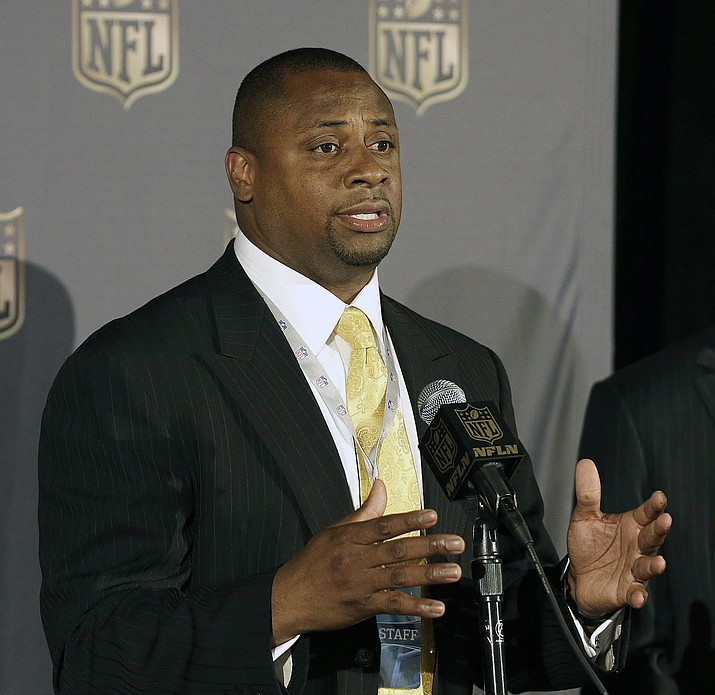 In this May 19, 2015, file photo, Troy Vincent, NFL executive vice president of football operations, speaks at the NFL's spring meetings in San Francisco. The NFL is launching a social justice platform, with an emphasis on education, economic development and community and police relations. Vincent emphasizes how much work has been done and continues to be done by the players. (Jeff Chiu/AP, file)