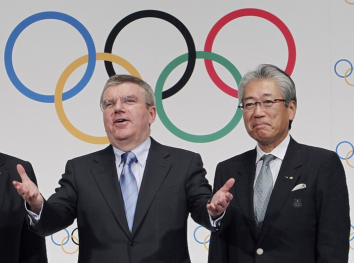 "This Nov. 20, 2013, file photo shows Japan Olympic Committee President Tsunekazu Takeda, right, and  International Olympic Committee (IOC) President Thomas Bach, left, following a press conference in Tokyo. France's financial crimes office says International Olympic Committee member Takeda is being investigated for corruption related to the 2020 Tokyo Olympics. The National Financial Prosecutors office says Takeda, the president of the Japanese Olympic Committee, was placed under formal investigation for ""active corruption"" on Dec. 10.(Junji Kurokawa/AP, file)"