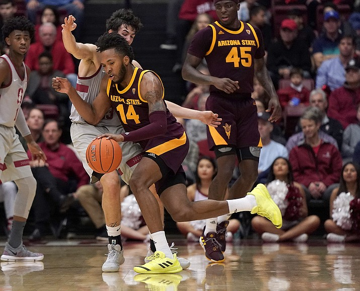 Arizona State forward Kimani Lawrence (14) drives against Stanford guard Cormac Ryan during the first half of an NCAA college basketball game in Stanford, Calif., Saturday, Jan. 12, 2019. (Tony Avelar/AP)