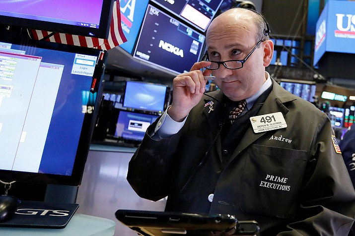 Trader Andrew Silverman works on the floor of the New York Stock Exchange, Friday, Jan. 11. Stocks are opening broadly lower on Wall Street, led by declines in banks and technology companies. (Richard Drew/AP)