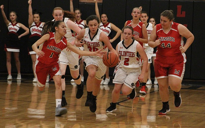 Mingus' Tyra Gabaldon knocks the ball loose from Lee Williams' Lia Lucero Friday night in a 35-34 setback to the Lady Volunteers. (Photo by Beau Bearden/Kingman Daily Miner)