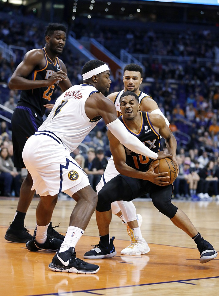 Denver Nuggets forward Paul Millsap (4) and Phoenix Suns guard De'Anthony Melton (14) vie for the ball during the second half during an NBA basketball game, Saturday, Jan. 12, 2019, in Phoenix. The Suns defeated the Nuggets 102-93. (Rick Scuteri/AP)