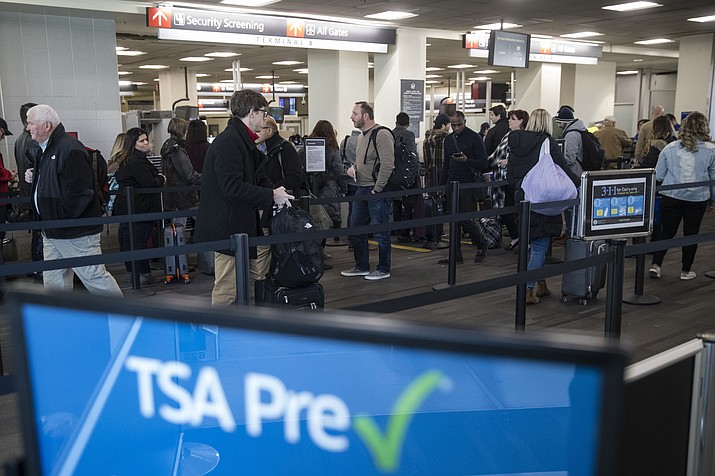 Passengers wait in line at a Transportation Security Administration checkpoint at the Philadelphia International Airport in Philadelphia, Friday, Jan. 11, 2019. (Matt Rourke/AP)