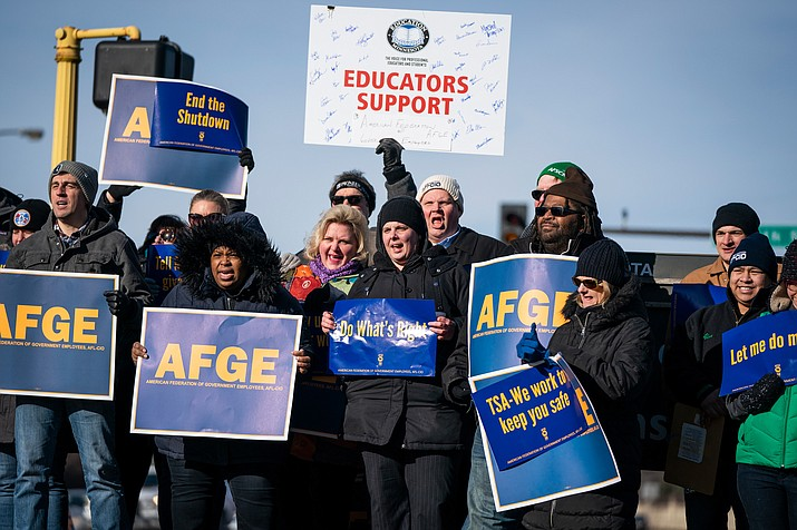 Government workers, American Federation of Government Employees union members and members of supporting local unions, pose for a group photo during the rally to highlight the effect the federal shutdown, Thursday, Jan. 10, in Minneapolis. (Leila Navidi/Star Tribune via AP)