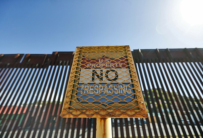 In this April 9, 2018, file photo, the international border between Mexico and the United States is seen from Nogales, Ariz. One of the four U.S. governors whose states share a boundary with Mexico, Ariz. Gov. Doug Ducey says solid walls, fences, law enforcement officers on the ground and advanced technology are all tools the United States can draw from to protect the country from illegal drugs and human trafficking entering from the south.(Matt York/AP, file)