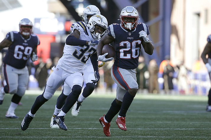 New England Patriots running back Sony Michel runs away from Los Angeles Chargers free safety Derwin James during the first half Sunday, Jan. 13, 2019, in Foxborough, Mass. (Steven Senne/AP)