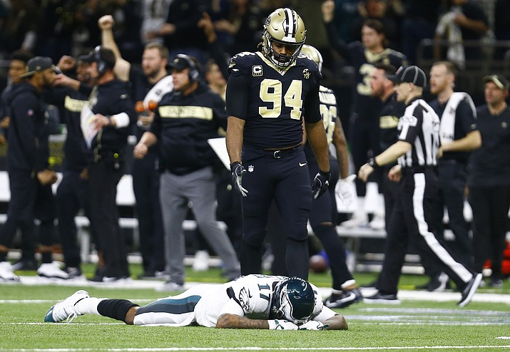 Philadelphia Eagles wide receiver Alshon Jeffery lies on the turf in front of New Orleans Saints defensive end Cameron Jordan after the Saints intercepted a pass in the second half in New Orleans, Sunday, Jan. 13, 2019. The Saints won 20-14. (Butch Dill/AP)