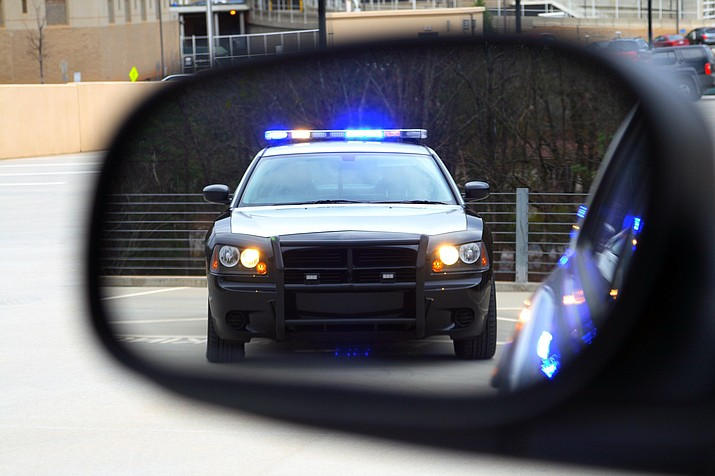 A court ruling in an Arizona case says law enforcement officers may not extend a lawful traffic stop because a passenger refuses to identify himself unless there's reasonable suspicion the passenger committed a crime. (Courier stock photo)