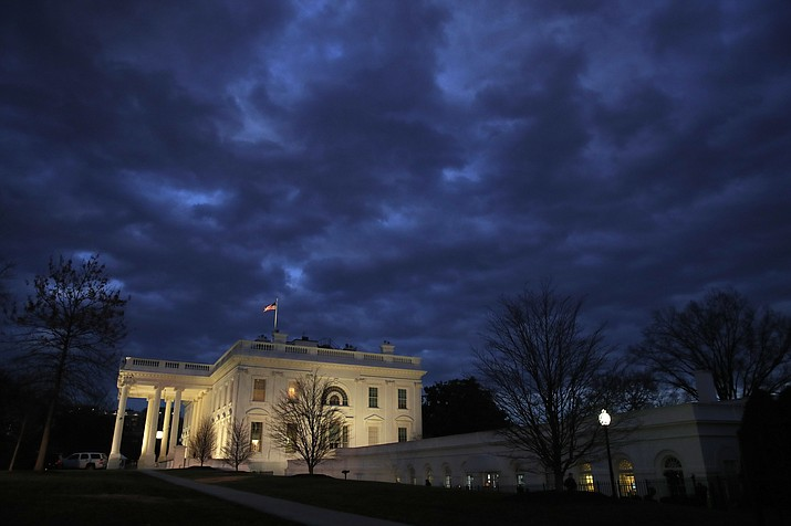 In this Jan. 8, 2019, photo, clouds roll over the White House, Tuesday Jan. 8, 2019, in Washington. The 2020 primary campaign is exploding 13 months before the first voters head to the polls. Candidates and potential candidates are hiring staff and traveling to key states all in a mad scramble to gain a leg up in what will be a rollicking Democratic primary. (AP Photo/Jacquelyn Martin, File)