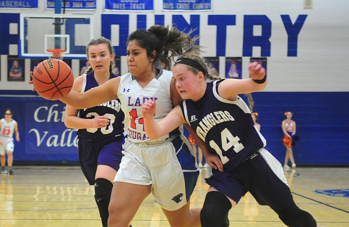 Chino Valley's Crystal Sanchez (14) gets fouled driving into the lane as the Cougars host Wickenburg on Monday, Jan. 14, 2019, in Chino Valley. The No. 21-ranked Cougars ended a three-game losing streak with a 35-23 victory over the Wranglers. Chino Valley had won four straight going into Christmas, but lost three in a row to Mayer, Kingman and Northwest Christian before rebounding Monday night. The Cougars (6-7,  1-2 West) travel to River Valley on Friday, Jan. 18. Tipoff is set for 5 p.m. (Les Stukenberg/Courier)