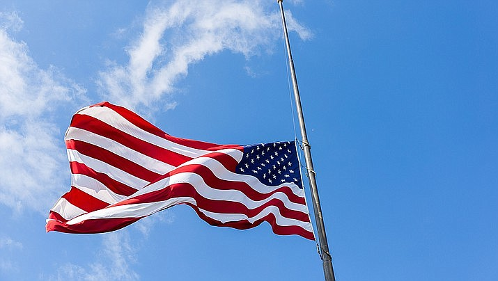 Governor orders flags at half-staff for fallen police officer.