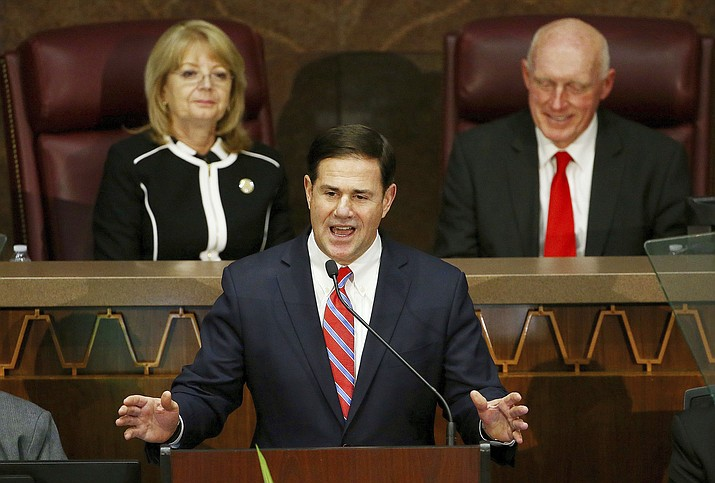 Gov. Doug Ducey speaks during his State of the State address as he talks about Arizona's economy, new jobs and the state revenue as Senate President Karen Fann, R-Prescott, left, and House Speaker Rusty Bowers, R-Mesa, right, listen Monday, Jan. 14, 2019, in Phoenix. (Ross D. Franklin/AP)