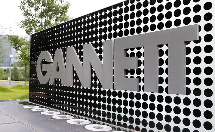In this July 14, 2010, file photo, the Gannett Co. headquarters sign stands in McLean, Va. The Wall Street Journal is reporting that MNG Enterprises, better known as Digital First Media, is preparing to bid for newspaper publisher Gannett Co. (Jacquelyn Martin/AP, file)