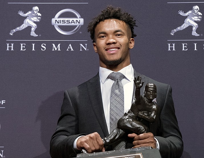 In this Dec. 8, 2018, file photo, Oklahoma quarterback Kyler Murray poses with the Heisman Trophy after winning the award in New York. Kyler Murray, the first-round Major League Baseball draft pick and Heisman Trophy-winning Oklahoma quarterback, says he is declaring himself eligible for the NFL draft. Murray announced his decision Monday, Jan. 14, 2019, in a tweet. (Craig Ruttle/AP, file)