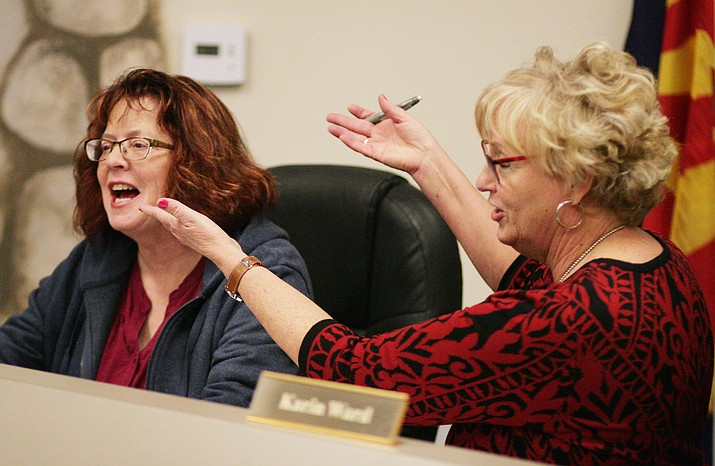 Beaver Creek School District Superintendent Karin Ward, right, presents Jackie Harshman as the board's president for 2019. VVN/Bill Helm