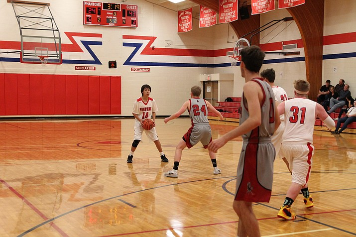 Caius Kennedy sets up the offense for the Phantoms during a game against Mogollon Jan. 11. (Erin Ford/WGCN