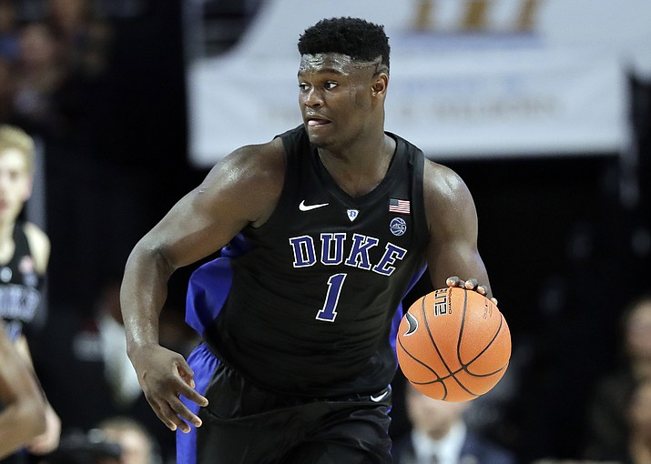 Duke's Zion Williamson (1) brings the ball up court against Wake Forest during the second half of an NCAA college basketball game in Winston-Salem, N.C., Tuesday, Jan. 8, 2019. (Chuck Burton/AP)