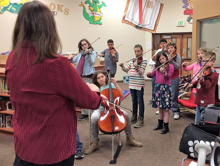 The Granville Elementary School orchestra, under the direction of Paula Stewart, entertains members of the Humboldt Unified School Board and the audience with its talent on Jan. 8. (Sue Tone/Tribune)