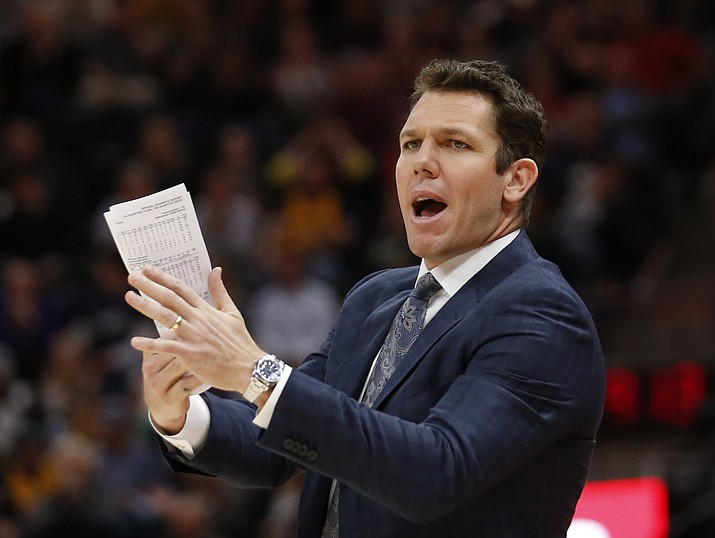 In this April 3, 2018 file photo, Los Angeles Lakers head coach Luke Walton shouts to his team in the second half during an NBA basketball game against the Utah Jazz in Salt Lake City. Luke Walton began a wellness program for his Lakers coaching staff. Steve Kerr called Steve Clifford in support after each spent significant time away from the sideline because of debilitating headaches among other symptoms. The NBA Coaches Association now provides guidance to its members on everything from diet and exercise to sleep and mental health. (Rick Bowmer/AP, file)