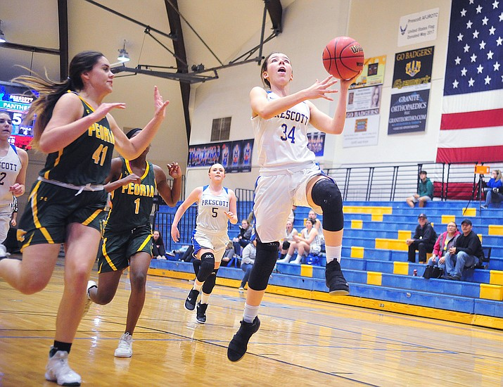 Prescott's Hollie Dalton takes a steal to the basket as the Badgers take on the Peoria Panthers Tuesday Jan. 15, 2019 in Prescott. (Les Stukenberg/Courier)