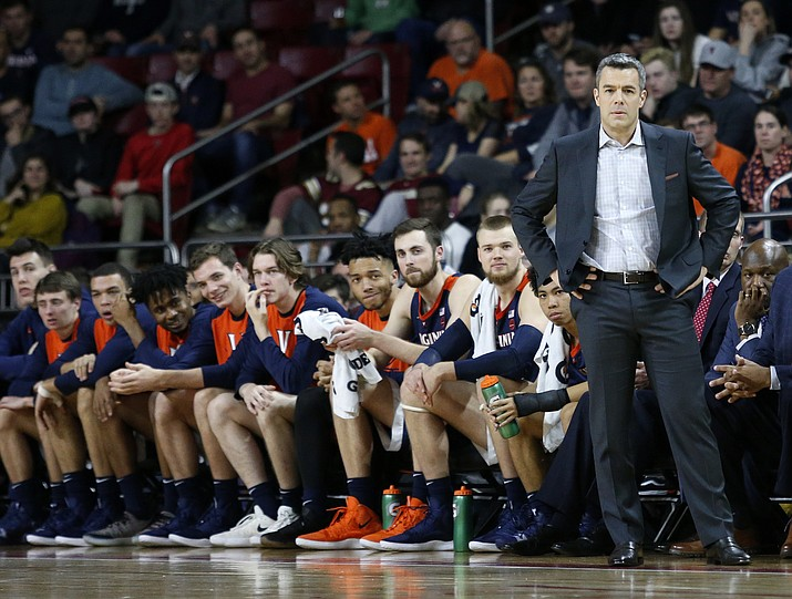 In this Wednesday, Jan. 9, 2019, file photo, Virginia head coach Tony Bennett stands at the bench during the first half of an NCAA basketball game against Boston College, in Boston. The fourth-ranked Cavaliers face No. 9 Virginia Tech and No. 1 Duke the week of Jan. 14. (Mary Schwalm/AP, file)