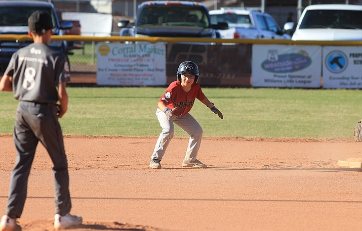 A player looks to steal during the 2018 summer Little League season.