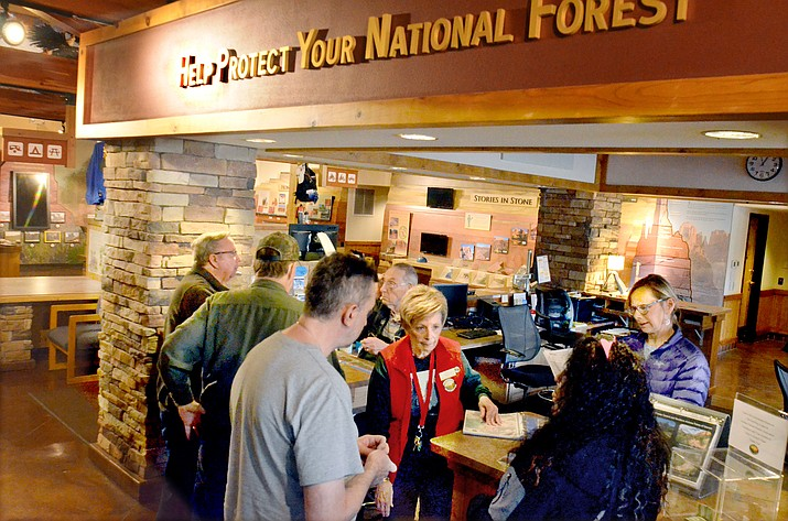 Volunteers help a steady stream of visitors on Monday at the Red Rock Rangers Station on SR89a in the Village of Oak Creek in Sedona. VVN/Vyto Starinskas