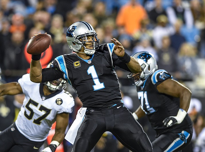 Carolina Panthers quarterback Cam Newton (1) looks to pass during the first half of a NFL football game against the New Orleans Saints in Charlotte, N.C., Monday, Dec. 17, 2018. (Mike McCarn/AP)