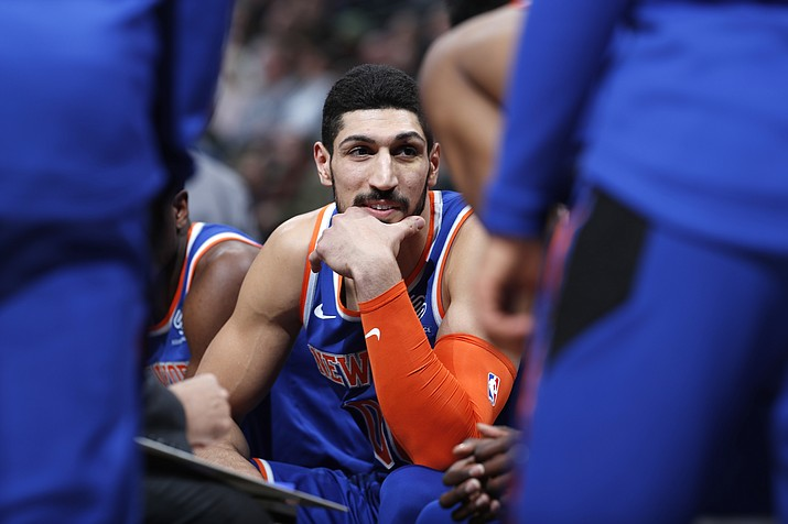 In this Jan. 1, 2019, file photo, New York Knicks center Enes Kanter jokes with teammates during a timeout the first half of the team's NBA basketball game against the Denver Nuggets, in Denver. Turkish prosecutors are seeking an international arrest warrant for Knicks player Enes Kanter, accusing him of membership in a terror organization. (David Zalubowski/AP, file)