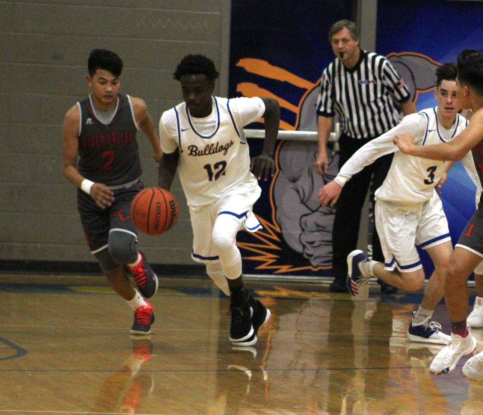 Prep Basketball: Bulldogs suffer a tough loss to River ...