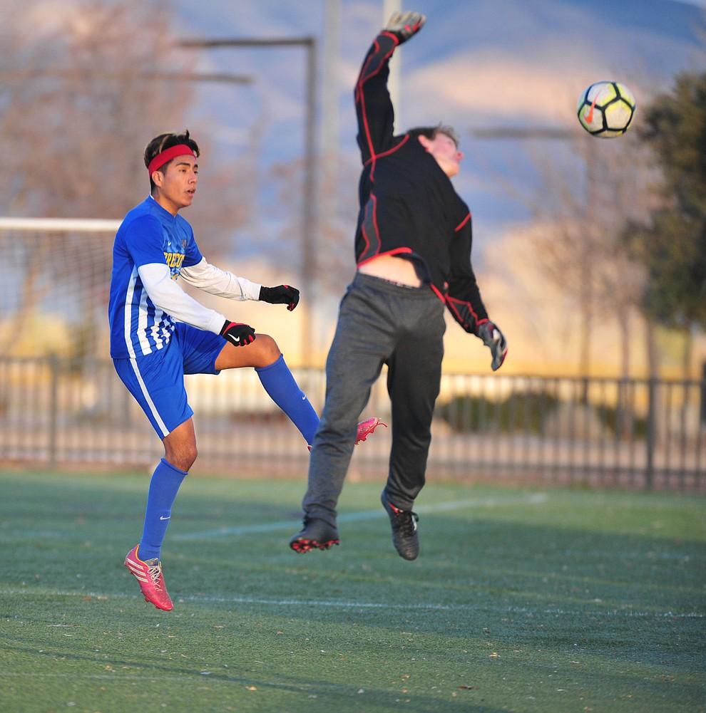 Prescott's Fernando Rodrigues is denied by Elijah Gagnon as the Badgers take on the Mingus Marauders Wednesday Jan. 16, 2019 in Prescott Valley. (Les Stukenberg/Courier).